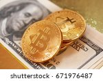 golden bitcoin on a gold... | Shutterstock . vector #671976487