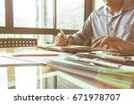 men work with calculators and... | Shutterstock . vector #671978707