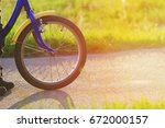 child riding bike at sunset | Shutterstock . vector #672000157