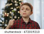 little boy is holding a brussel ... | Shutterstock . vector #672019213