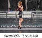 blonde model in high heels | Shutterstock . vector #672021133
