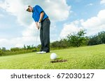 asian golfer long putting golf... | Shutterstock . vector #672030127