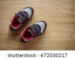 kids shoe sneaker on wooden... | Shutterstock . vector #672030217