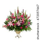 large flower arrangement on... | Shutterstock . vector #672057667