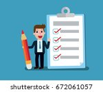 happy businessman holding a... | Shutterstock .eps vector #672061057