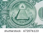 the pyramid and eye on the back ... | Shutterstock . vector #672076123