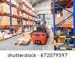 Small photo of Forklift in Warehouse storage of retail merchandise shop.
