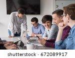 business team meeting in modern ... | Shutterstock . vector #672089917