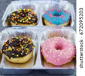 tasty glazed colorful donuts on ... | Shutterstock . vector #672095203