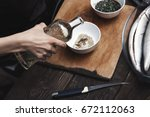 woman preparing marinade for... | Shutterstock . vector #672112063
