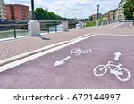 the new bicycle path.... | Shutterstock . vector #672144997