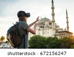 a traveler with virtual reality ... | Shutterstock . vector #672156247
