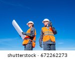 two engineers at airport runway | Shutterstock . vector #672262273