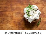 fresh greek feta cheese.... | Shutterstock . vector #672289153