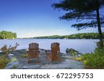 Two Muskoka Chairs Sitting On ...