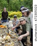 Small photo of NEW YORK, Oct. 8, 2016 -- Members of the New York Mycological Society identify edible and poisonous mushrooms on a picnic table in South Mountain Reservation, New Jersey.