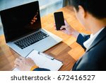 businessman using laptop and... | Shutterstock . vector #672416527