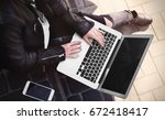 Young Girl Using Laptop Outdoors