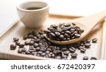 coffee cup and coffee beans on... | Shutterstock . vector #672420397