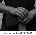man holding an old rusty ax.... | Shutterstock . vector #672422467