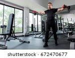 fitness men lifting dumbbell in ... | Shutterstock . vector #672470677