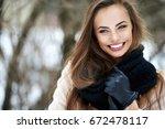 beautiful smiling woman outdoor ... | Shutterstock . vector #672478117