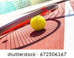 tennis balls and racket on the... | Shutterstock . vector #672506167