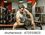 man workingout in the local gym | Shutterstock . vector #672510823