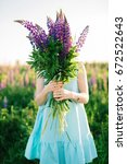 girl with a bouquet in the... | Shutterstock . vector #672522643