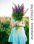 girl with a bouquet in the... | Shutterstock . vector #672522703