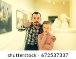 amazed father and daughter... | Shutterstock . vector #672537337