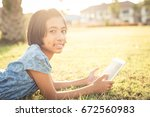asian girl is using a tablet in ...   Shutterstock . vector #672560983