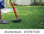 mowing the lawn in front of my... | Shutterstock . vector #672567133