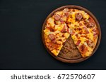 top view homemade pizza with...   Shutterstock . vector #672570607