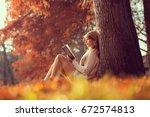 beautiful young brunette...   Shutterstock . vector #672574813