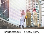 arab businessmen and architects ... | Shutterstock . vector #672577597