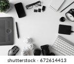 top view of creative workspace  ...   Shutterstock . vector #672614413