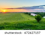 sunset at cultivated land in... | Shutterstock . vector #672627157