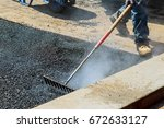workers on asphalting paver... | Shutterstock . vector #672633127
