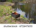 a burning brazier on a... | Shutterstock . vector #672647653