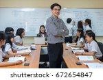 portrait of asian teacher...   Shutterstock . vector #672654847