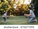 handsome dad with his little... | Shutterstock . vector #672677293