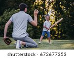 handsome dad with his little... | Shutterstock . vector #672677353
