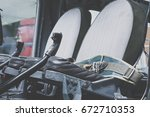 seats in a cockpit of a... | Shutterstock . vector #672710353