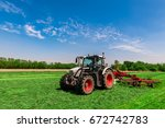 Tractor Raking Grass On The...