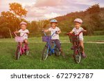 three child riding a bicycle.... | Shutterstock . vector #672792787