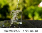 pour into a glass | Shutterstock . vector #672813313