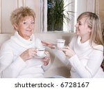 mother and daughter drinking... | Shutterstock . vector #6728167