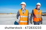two engineers at airport runway | Shutterstock . vector #672833233