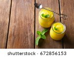 two glass jars with delicious... | Shutterstock . vector #672856153